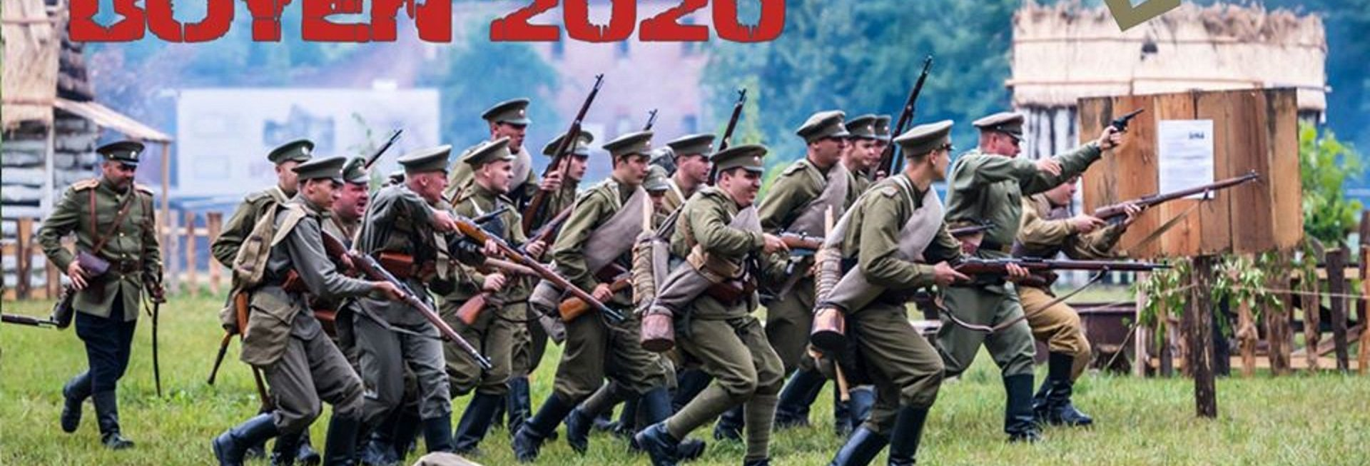 Zdjęcie zapraszające w dniach 6-9 sierpnia do Giżycka na Święto Twierdzy Boyen Operacja Boyen 2020. Zdjęcie przedstawia inscenizację bitwy, na której widzimy atakujących żołnierzy w mundurach z epoki I Wojny Światowej.