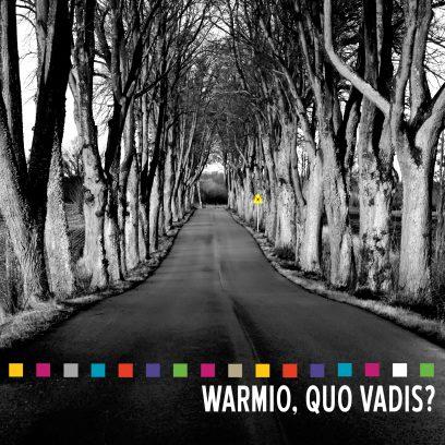 Zdjęcie okładki publikacji pod tytułem Warmio, Quo Vadis?  Na zdjęciu mazurska droga otoczona po obu stronach drzewami.