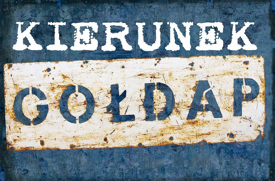 """Plakat graficzny zapraszający do Gołdapi na cykliczną imprezę Kierunek Gołdap 2021. Plakat o niebieskim tle na którym naniesiony jest napis """"Kierunek Gołdap""""."""